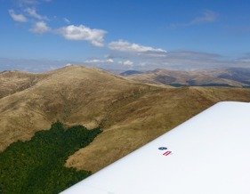 Flying over the edge of southern Carpathian Mountains on the route Arad - Bucharest